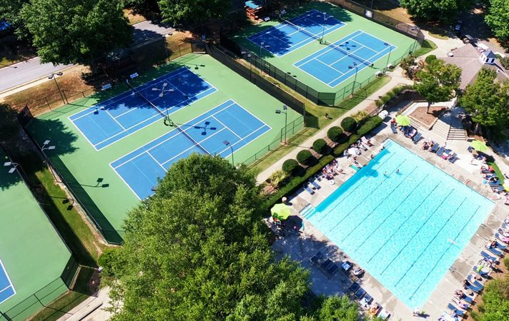 Drone photography of neighborhood pool and tennis courts for Polo Golf and Country Club.