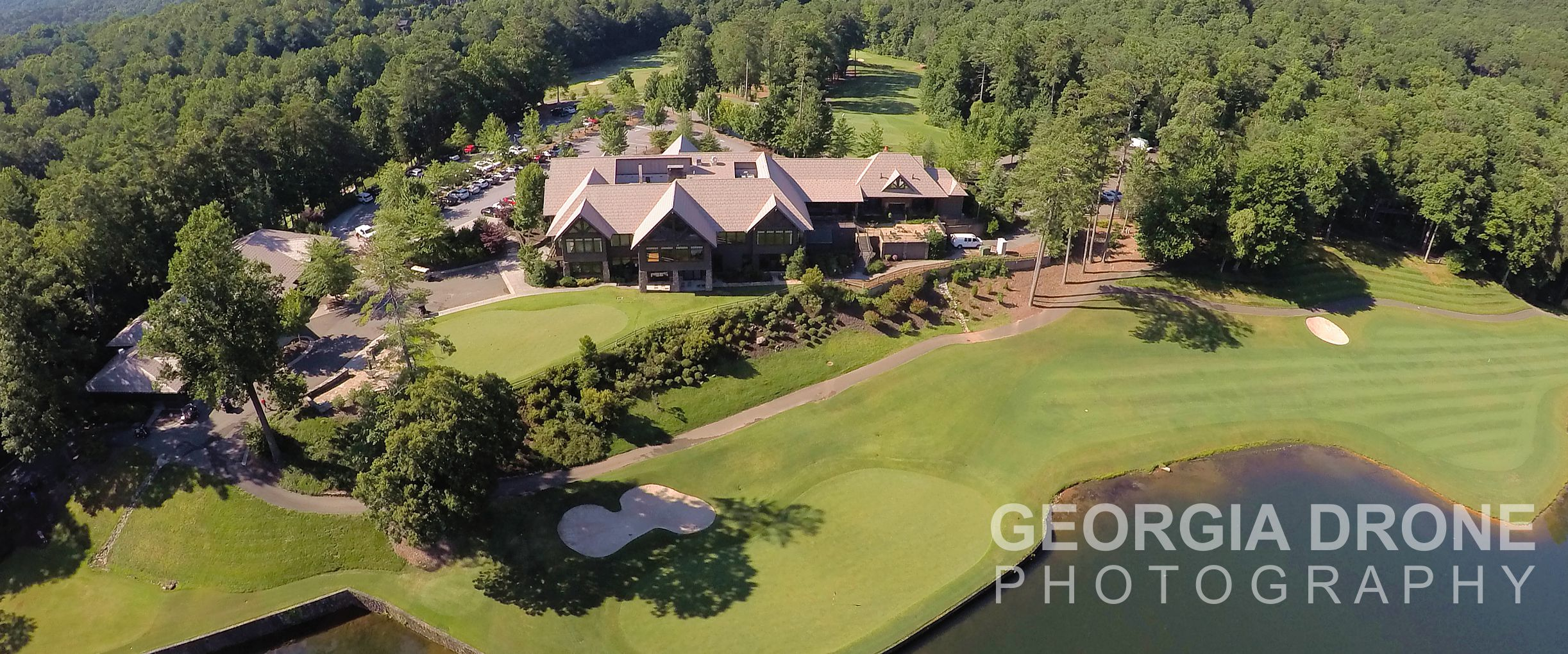 Drone photography of Big Canoe clubhouse on golf course in Jasper, Georgia.