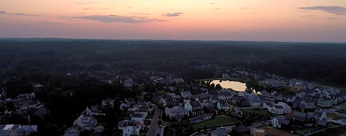 Drone photography of sunset over vickery subdivision in Cumming GA